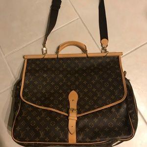 Louis Vuitton garment/duffel bag .